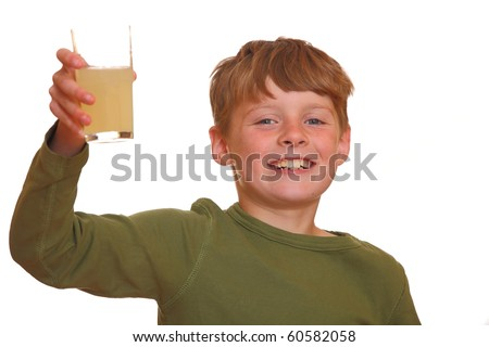 Young boy shows a glass of juice