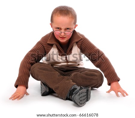 Young boy sitting on a white background. - stock photo