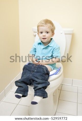Young Boy Sitting on Toilet Seat - stock photo