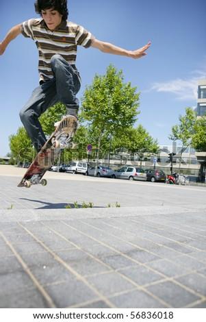 Young boy skateboarding - stock photo