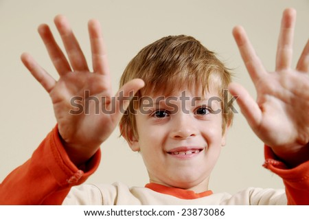 Young boy smiling and gesturing - stock photo