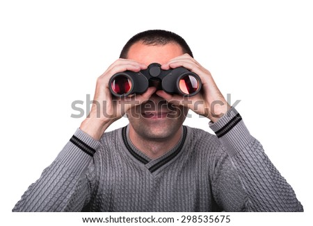 Young boy smiling and looking through binoculars on a white background