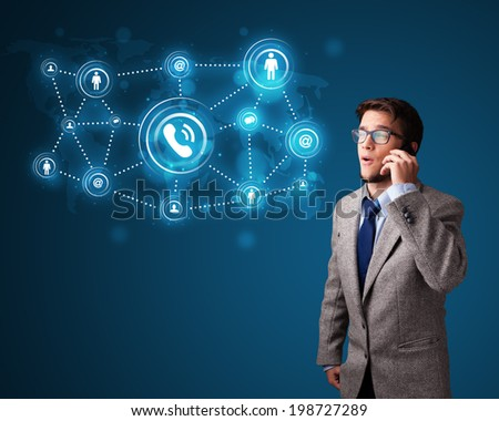 Young boy standing and making phone call with social network icons