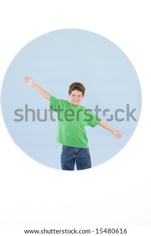 Young boy standing with arms out smiling - stock photo