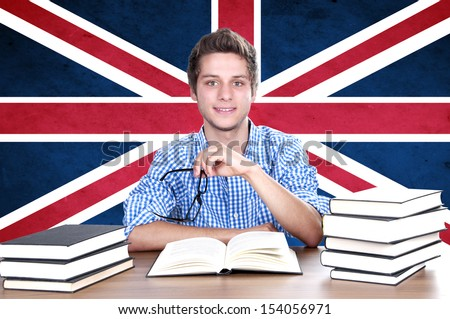 young boy student  on the background with UK flag. English language learning concept