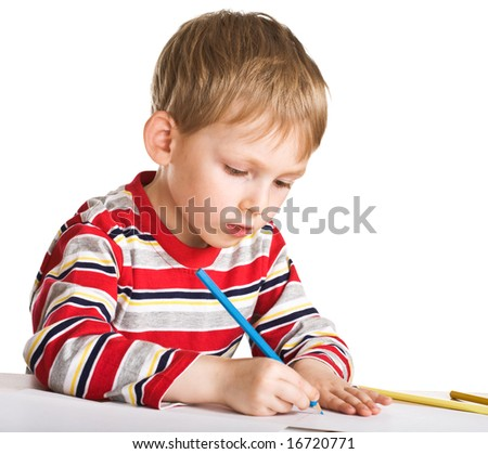 Young boy studies to draw - stock photo