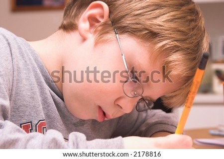 Young Boy Studying - stock photo