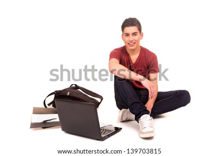 Young boy studying, isolated over a white background - stock photo