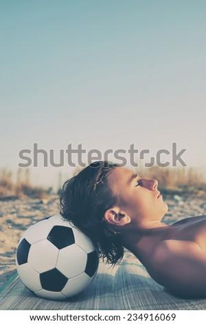 Young boy sunbathing on beach, close up - stock photo