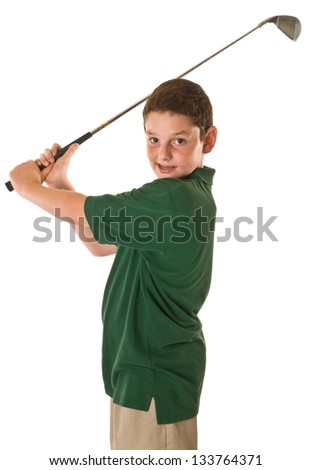 Young boy swinging a golf club - stock photo