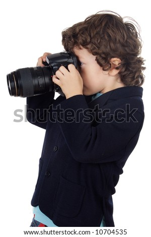 Young boy taking photo with camera over white background