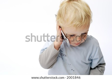 Young boy talking on mobile telephone - stock photo