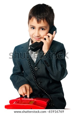 young boy talking on the phone isolated on white background - stock photo