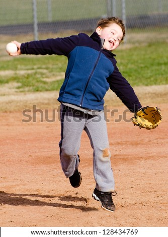 Young boy throwing ball at T-ball practice - stock photo