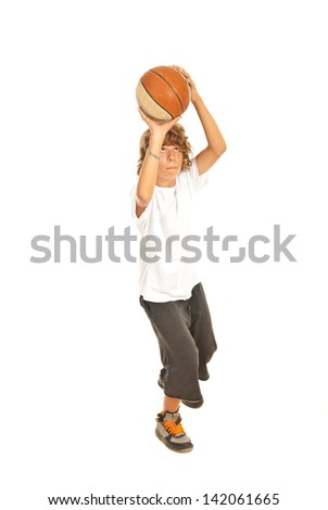 Young boy throwing basketball isolated on white background - stock photo