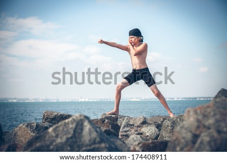 Young boy training karate - stock photo