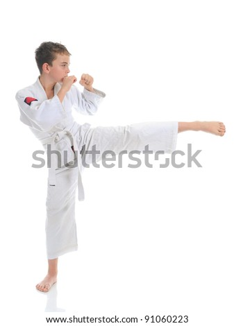 Young boy training karate. Isolated on white background - stock photo