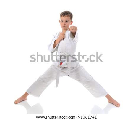 Young boy training karate. Isolated on white background - stock photo