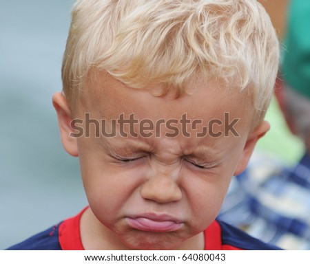 Young Boy Unhappy Expression - stock photo
