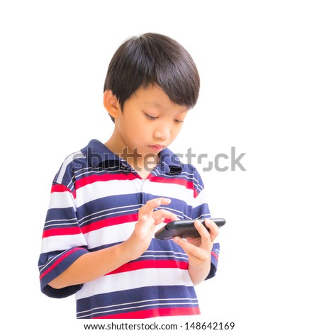 young boy using mobile phone - stock photo