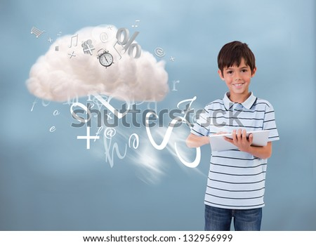 Young boy using tablet to connect to cloud computing and accessing many applications - stock photo