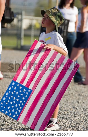 Young boy waiting for his Father returning from Iraq - stock photo