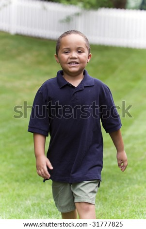 Young boy walking in garden