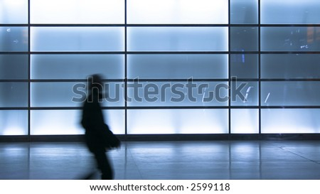 Young boy walking through the passage from the Potsdamer Platz - stock photo