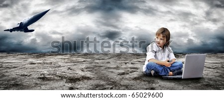 Young boy watch in the field-glass under sky