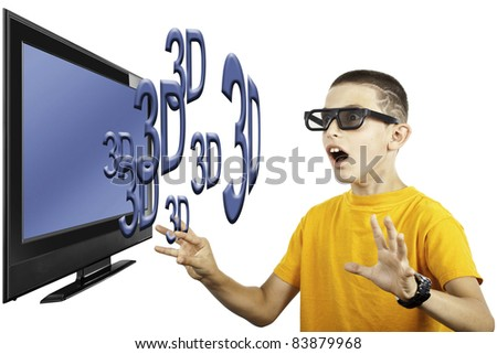 young boy watching 3D television - stock photo