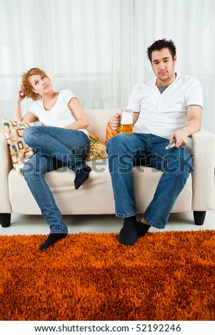 young boy watching television with a  beauty, young girl