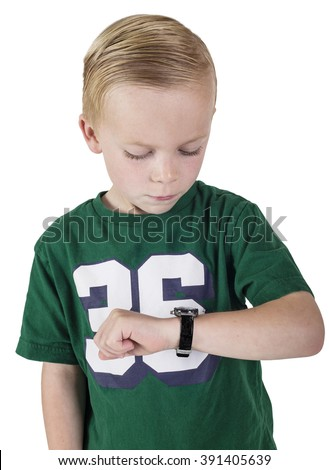 Young boy watching the time on his wristwatch. What time is it. - stock photo