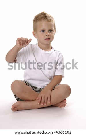 "young boy waving or throwing the ""shaka"""