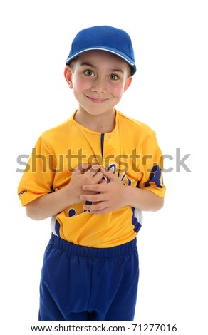Young boy wearing a baseball or T-ball style sport outfit and blue cap.  White background. - stock photo