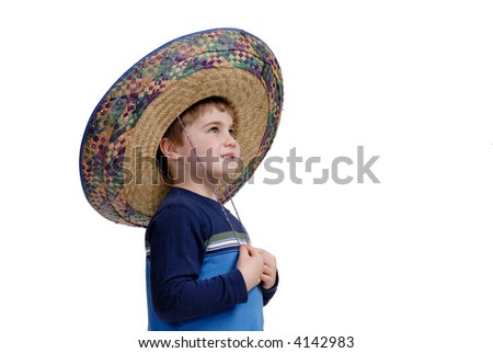 Young boy wearing a sombrero thinking about his vacation, isolated on white - stock photo