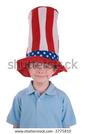 Young boy wearing a stars and stripes patriotic top hat. - stock photo
