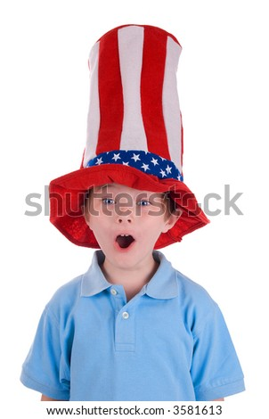 Young boy wearing a stars and stripes patriotic top hat with a funny expression on his face. - stock photo
