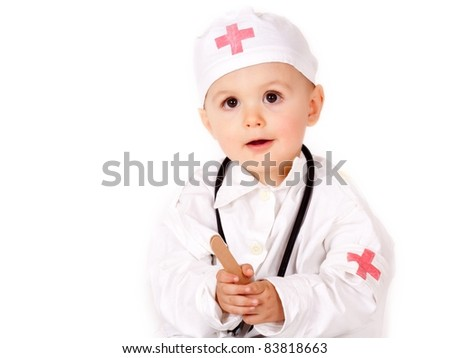 Young boy wearing as doctor - stock photo