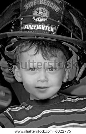 Young Boy Wearing Fireman's Hat - stock photo