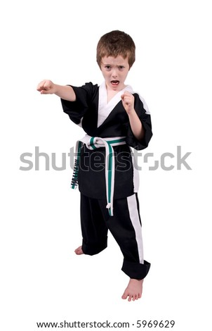 Young boy Wearing Karate Outfit over a white background - stock photo