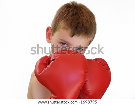 young boy wearing red boxing gloves - stock photo