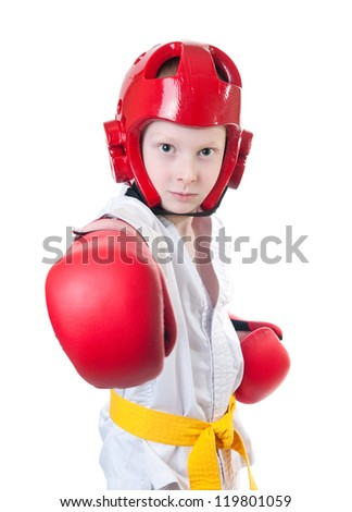 Young boy wearing tae kwon do uniform, protective helmet and boxing gloves - stock photo