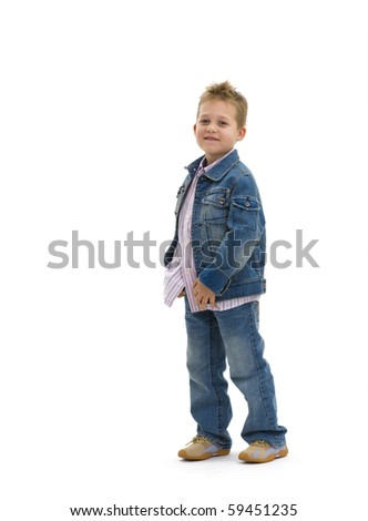 Young boy wearing trendy jeans jacket and shirt, standing on isolated white background. - stock photo
