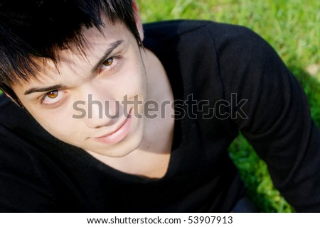 young boy who looks at camera