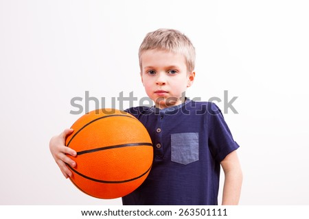 young boy with a basketball ball - stock photo