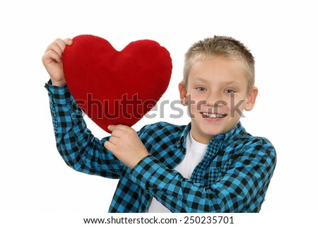 Young boy with a heart in his hand on Valentine's Day - stock photo