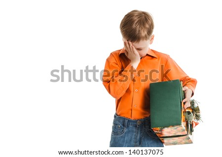 young boy with a present box disappointed - stock photo