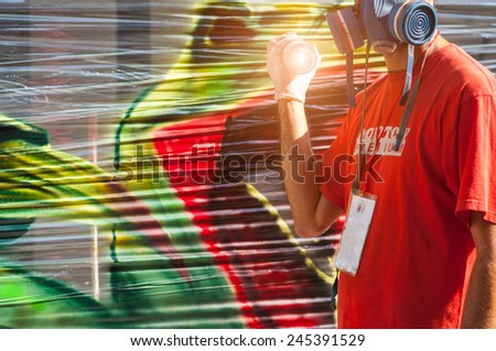 young boy with a spray can - stock photo