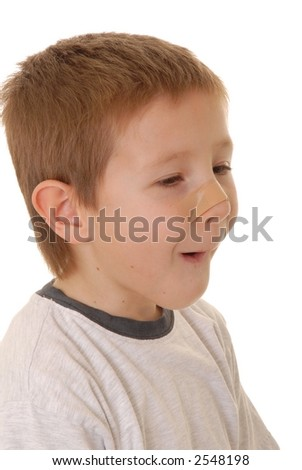 Young boy with an injury covered by a band-aid