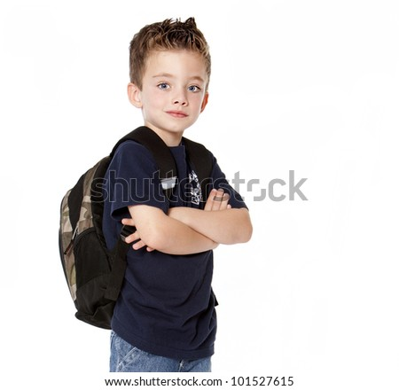 Young boy with backpack isolated on white background - stock photo
